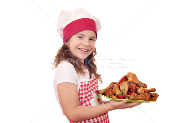 happy little girl cook with roasted chicken drumsticks Stock photo © goce