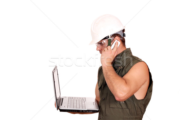 oil worker with laptop and phone on white Stock photo © goce