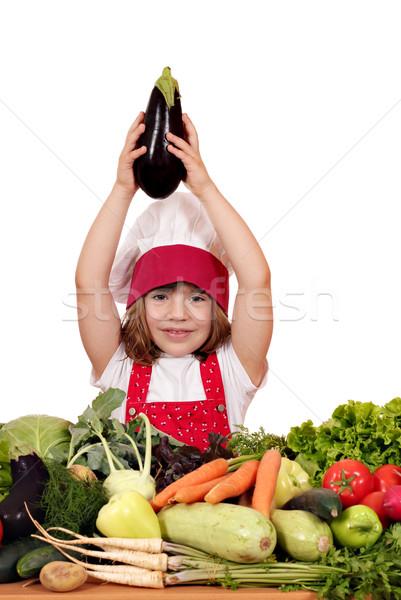 little girl cook holding aubergine over his head  Stock photo © goce