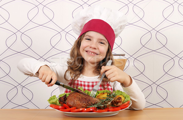 happy little girl cook eating big turkey drumstick Stock photo © goce