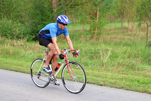 male cyclist on a race bike Stock photo © goce