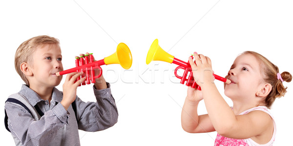 boy and little girl play trumpet Stock photo © goce