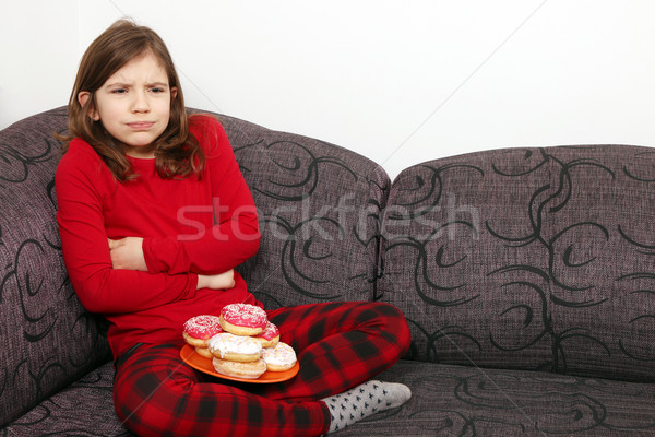little girl stomach ache because he ate a lot of donuts Stock photo © goce