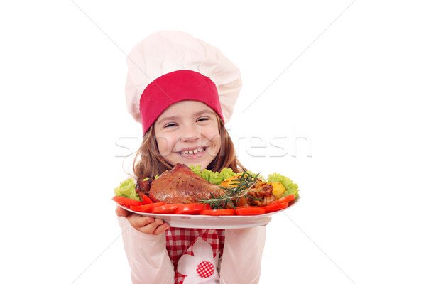 happy little girl cook with roasted turkey drumstick Stock photo © goce