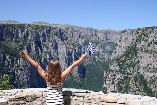 little girl waves with a Greek flag on Vikos gorge Zagoria Greec Stock photo © goce