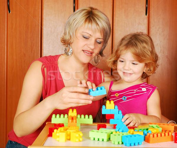 Stock fotó: Anya · lánygyermek · játszik · építőkockák · család · szeretet