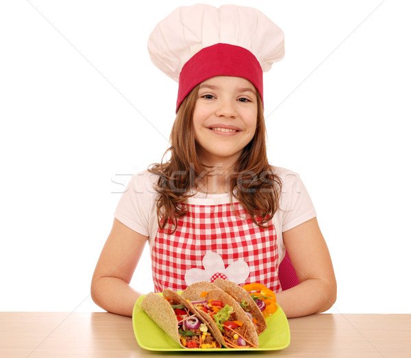 Happy little girl cook with tacos on table Stock photo © goce