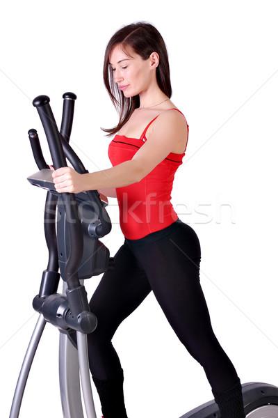 girl fitness exercise cross trainer Stock photo © goce