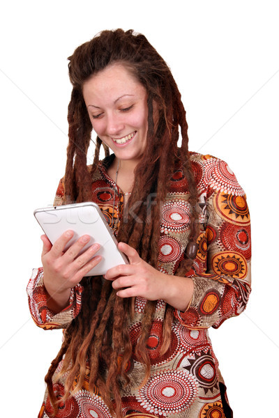 happy girl with dreadlocks hair play tablet pc Stock photo © goce