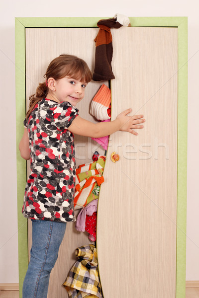 panic little girl trying to close the closet  Stock photo © goce