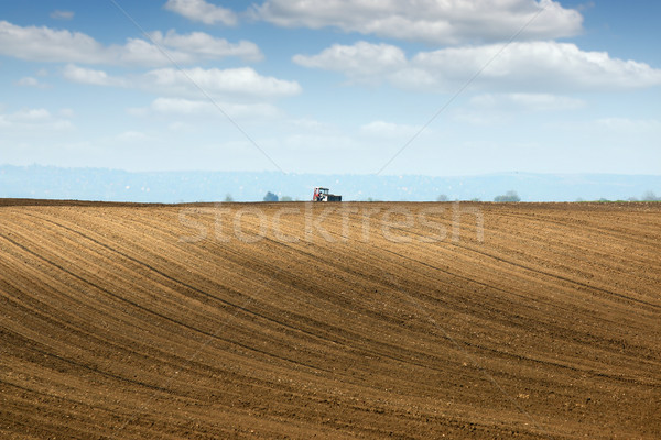 brown plowed field and tractor landscape Stock photo © goce