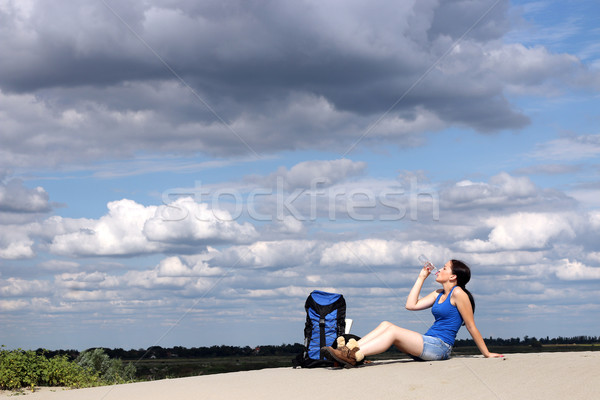 girl hiker sitting on the sand and drinking water  Stock photo © goce