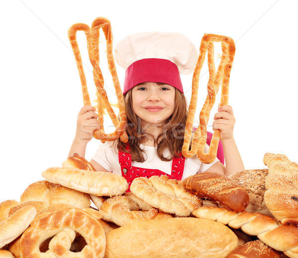 little girl cook with pastry pretzels and breads Stock photo © goce