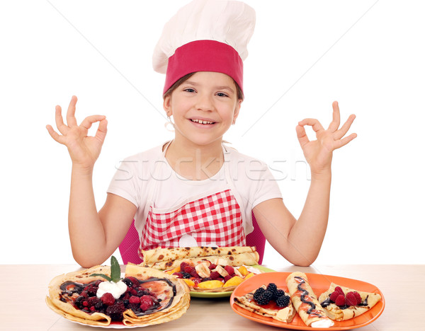 Boldog kislány szakács ok kézjel lány Stock fotó © goce
