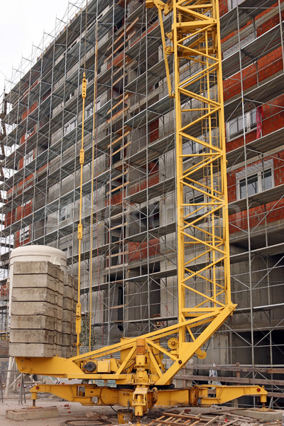 building construction site with scaffolding platforms and machin Stock photo © goce