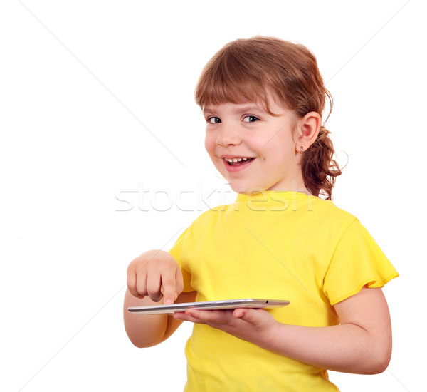 happy little girl playing with tablet pc Stock photo © goce