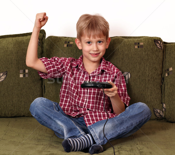 happy boy play video game Stock photo © goce