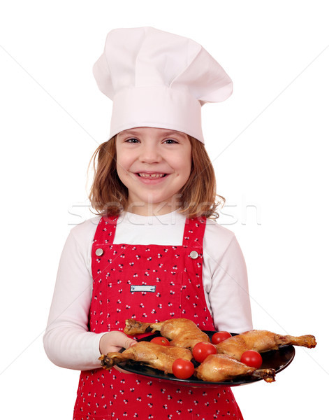 happy little girl cook with delicious chicken drumsticks Stock photo © goce