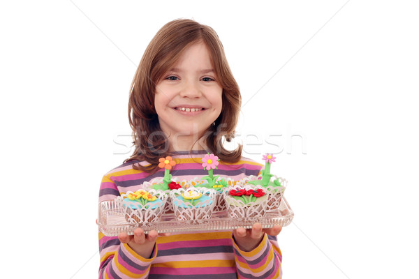 happy little girl with spring flowers muffin Stock photo © goce