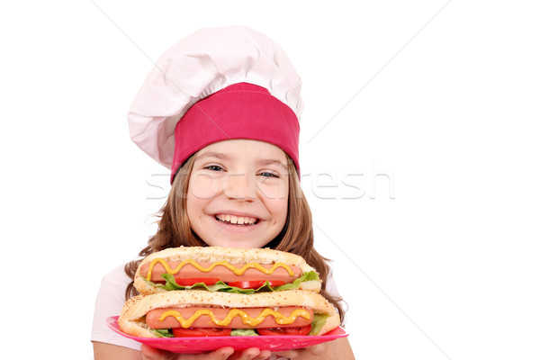 happy little girl cook with hot dogs fast food Stock photo © goce