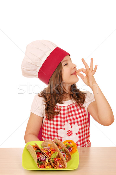 little girl cook with tacos fast food and ok hand sign Stock photo © goce