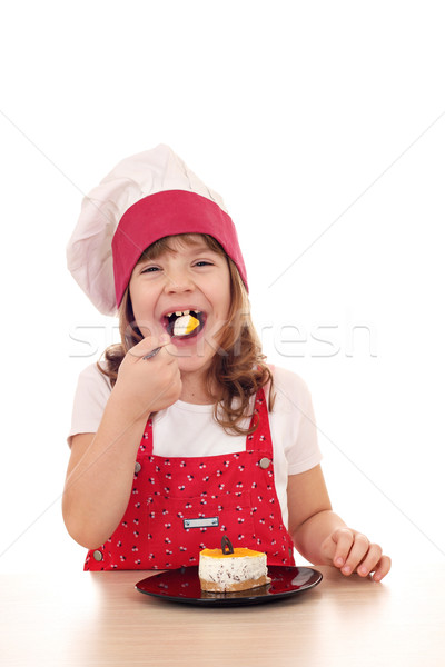hungry little cook girl eat cake Stock photo © goce