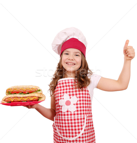 happy little girl cook with hot dogs and thumb up Stock photo © goce