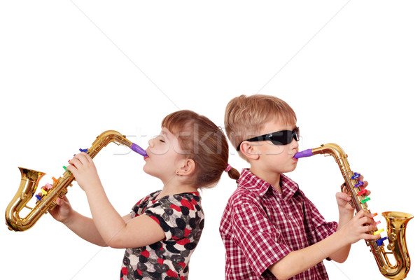 Stok fotoğraf: Küçük · kız · erkek · oynama · saksofon · müzik · mutlu
