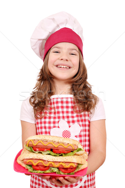happy little girl cook with hot dogs on plate Stock photo © goce