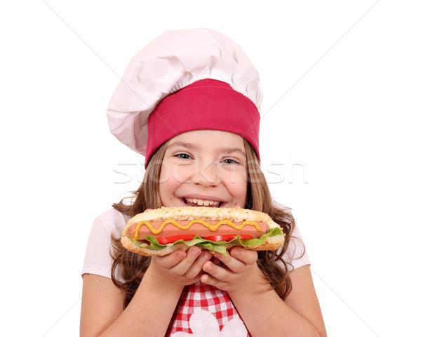 Mutlu küçük kız pişirmek sosisli sandviç kız çocuk Stok fotoğraf © goce