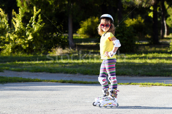 little girl with roller skates and protective equipment Stock photo © goce
