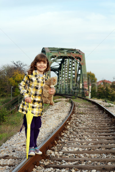 beautiful little girl standing on railroad Stock photo © goce