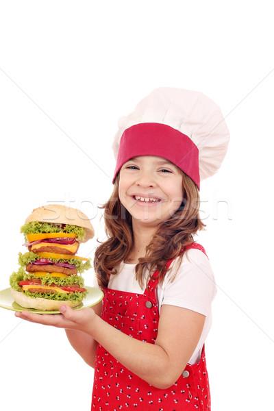 Felice bambina cuoco grande hamburger alimentare Foto d'archivio © goce