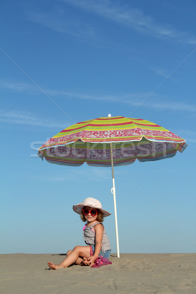 little girl under sunshade Stock photo © goce