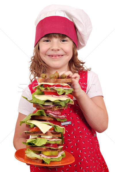 beautiful little girl cook with tall sandwich Stock photo © goce
