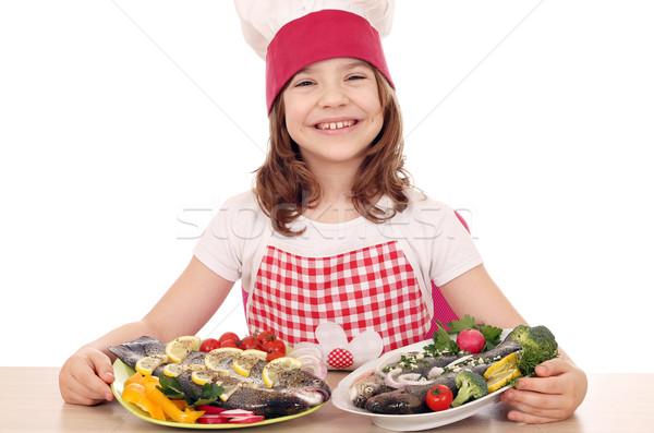 Boldog kislány szakács előkészített halfajok mosoly Stock fotó © goce