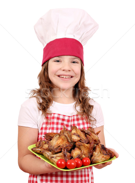 happy little girl cook with chicken wings Stock photo © goce