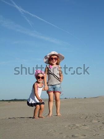 Dois little girl saltando praia criança beleza Foto stock © goce