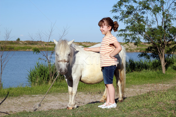 happy little girl with pony horse Stock photo © goce