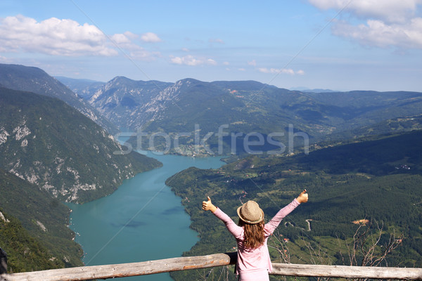 little girl with thumbs up standing on mountain viewpoint Stock photo © goce