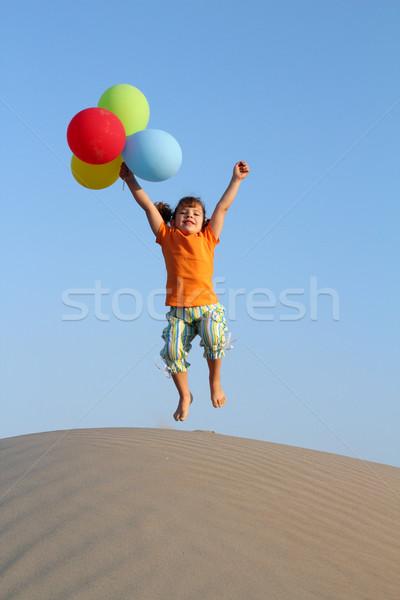 幸せ 女の子 ジャンプ 砂丘 ビーチ 笑顔 ストックフォト © goce