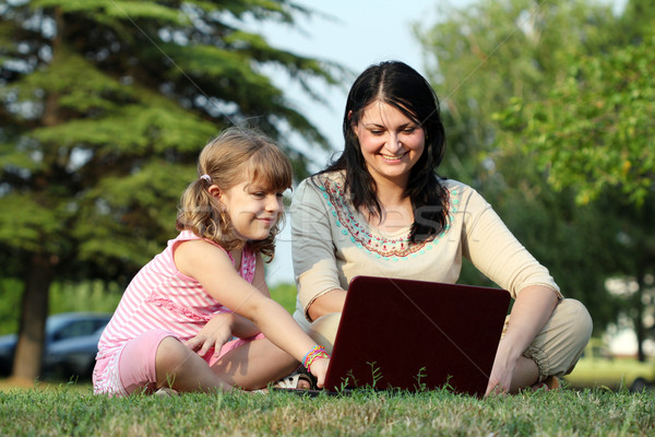 girl and child with laptop in park Stock photo © goce