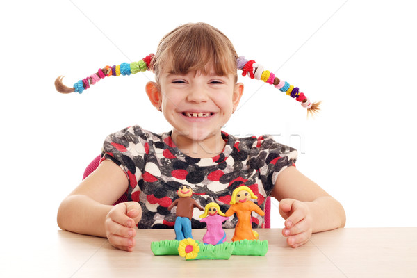happy little girl make family figure with plasticine Stock photo © goce