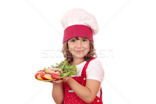 Szczęśliwy dziewczynka gotować przygotowany łososia dziewczyna Zdjęcia stock © goce
