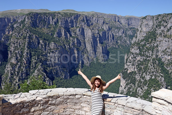 happy little girl with thumbs up on the viewpoint Vikos gorge Gr Stock photo © goce