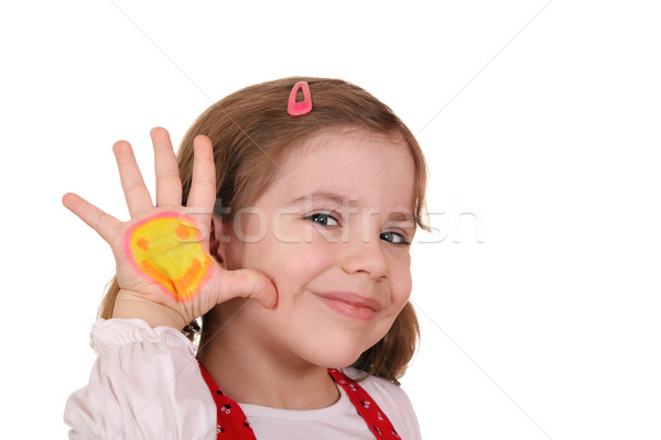 beautiful little girl with smiley on hand Stock photo © goce