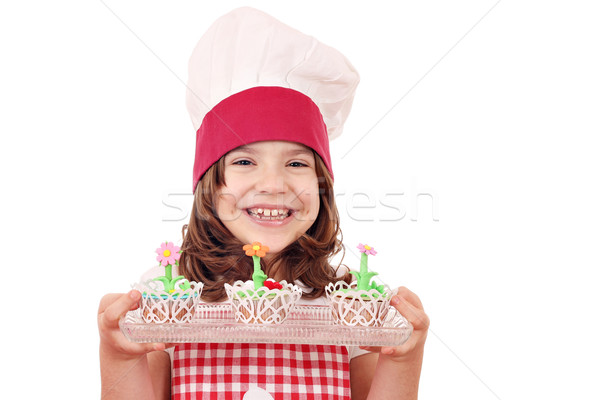 happy little girl cook with spring flower muffin Stock photo © goce