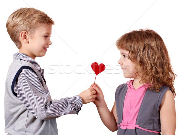 boy gives a little girl heart Stock photo © goce