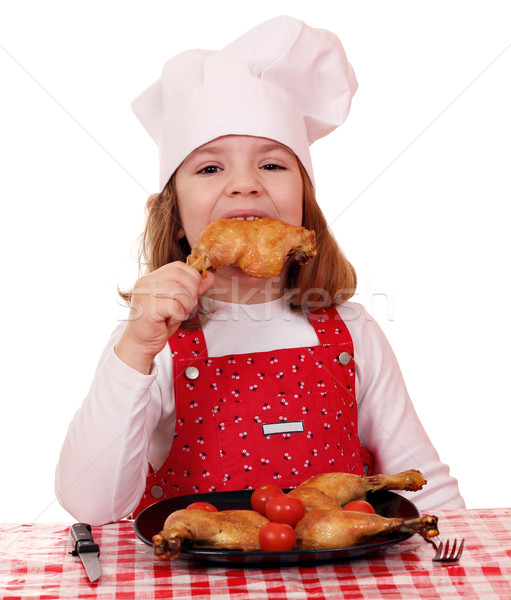 hungry little girl cook eat chicken drumstick  Stock photo © goce