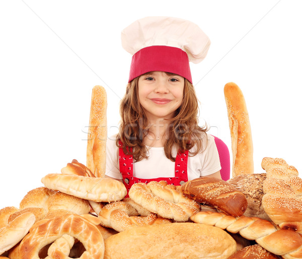 happy little girl cook with bread buns pretzels and rolls Stock photo © goce